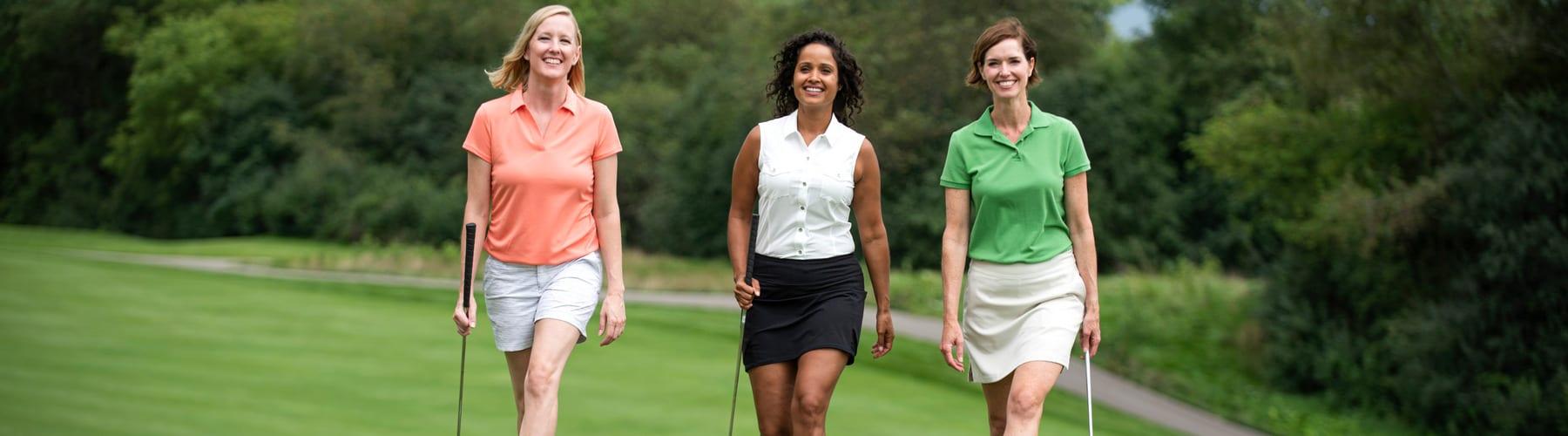Three women golfing